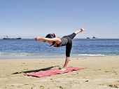 Bikram Yoga Tuladandasanal Pose At Beach