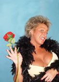 foto of clevage  - Wild party girl in swimsuit and feather boa posing with long stemmed red rose - JPG