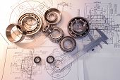 Bearings And Drawings Under A Desk Lamp poster