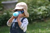 Boy With Sunglasses Drinking From Sippy Cup