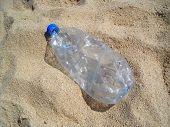 Plastic Bottle On Sand