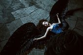 Angel with black wings poster