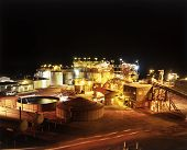stock photo of gold mine  - Elevated view of Gold Mine processing plant at night - JPG