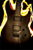 Burning Guitar On The Black Background