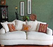picture of green wall  - white sofa in nice setting with green wall and decoration inviting setting for relaxation - JPG