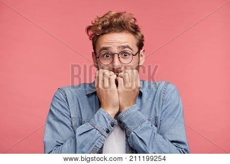 Nervous Embarassed Man Bites Nails