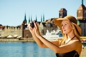 Beautiful Elegant Woman Caught On Taking Pictures poster