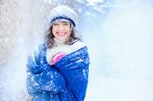 Winter Portrait Of A Young Woman. Beauty Joyous Model Girl Touching Her Face Skin And Laughing, Havi poster