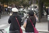 Asain Women Mother And Daughter Waiting For Crossing Traffic Road Go To Cathedrale Notre-dame De Par poster