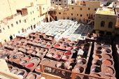 Coloration of leather in a traditional tannery in the city Fes, Morocco. Leather is colored with nat poster