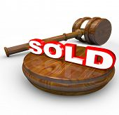 A gavel comes down on the word Sold to signify the end or closing of an auction and the buyer has be