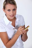 Young waitress with an order pad