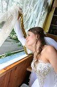 The Bride In A White Dress At A Window