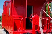 stock photo of caboose  - Old caboose newly painted in bright red - JPG
