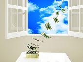 dollar money on table fly away