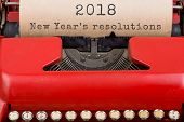 Christmas Concept - Red Typewriter With The Text 2018 New Years Resolutions. Close Up poster
