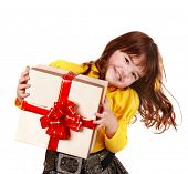 Girl child in yellow with gift box. Isolated.