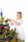 Nice Girl Decorates A Christmas Tree