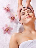 Beautiful young woman having massage.
