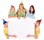 Group of young people in party hat holding banner. Isolated.