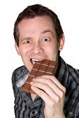 Man Eating A Mighty Hard Chocolate