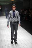 ZAGREB, CROATIA - MARCH 17: Fashion model wears clothes made by IK Studio on