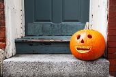 Funny Halloween Pumpkin On The Doorstep. Smiling Pumpkin With Braces. The Concept Of Dentist Office. poster