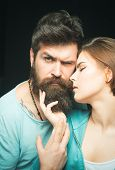 Fashion Shot Of Couple After Haircut. Woman On Mysterious Face With Bearded Man, Black Background. B poster