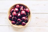Bowl Of Ripe Cherries With Stalks. Large Collection Of Fresh Red Ripe Cherry On Wooden Background. T poster