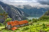 Norway, Kjeasen Mountain Farm, Eidfjord, Norway, Beautiful View Of Mountain In Fog and Fjordy, Norwa poster