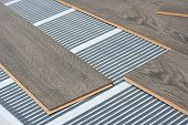stock photo of floor heating  - infrared floor heating system under laminate floor - JPG