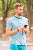 Living A Mobile Lifestyle. Athletic Man Tracking His Activity With Mobile Phone App. Sportsman Using poster