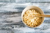 Instant Noodles On Wooden Background. Cooked Chinese Instant Noodles. Soup Ramen poster