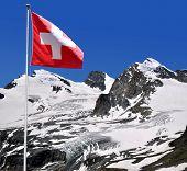 Strahlhorn,Rimpfischhorn and Allalinhorn with Swiss flag - Swiss Alps