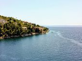 View Of A Small Traditional Croatian Town Along The Incredibly Beautiful Adriatic Sea While Driving  poster