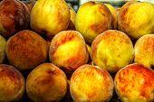 Ripe Peaches In The Market Close-up. Ripe Peaches In The Market Close-up. poster