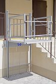 Living House Entrance Equipped With Special Lifting Platform For Wheelchair Users poster