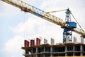 Crane. Self-erection Crane Over Construction Site. Crane Near Bulding. poster