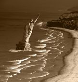 End of Days - Statue of Liberty in waters off the coast in a post-apocalyptic composite image.