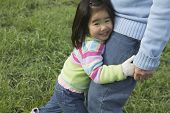 Young girl hugging grandfather