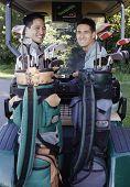 Two men in golf cart