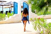 Slender Girl In A Bathing Suit Goes On The Road To The Beach With Thatched Umbrellas, Sibenik, Croat poster