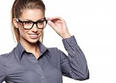 Eyewear glasses woman closeup portrait. Woman wearing glasses holding frame in close-up.