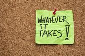 whatever it takes - motivational slogan - handwriting on a sticky note posted on a cork board
