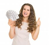 Happy Young Woman Showing Fun Of Dollars And Thumbs Up