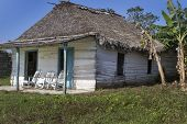 Small residential home on Cuba with rocking chairs