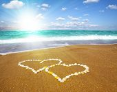 connected hearts on beach - love concept