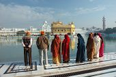 People Are Praying At Sacred Lake Of Famous Golden Temple , Amritsar