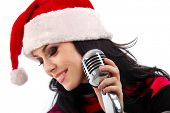 Christmas Singer standing in front of a microphone. Isolated on a white background (focus on microphone)