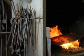 Tools And Fire In A Smithy